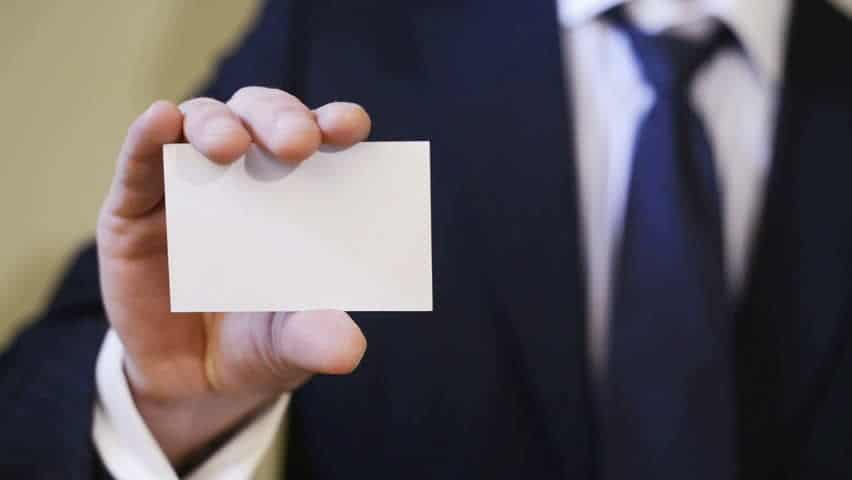 man holding out business card