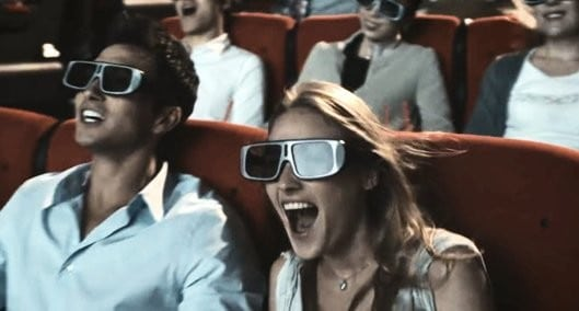 people at movie theater wearing 3d glasses